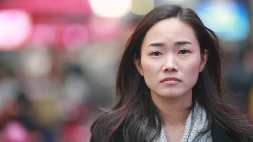 Asian woman in New York City Times Square street sad face portrait | Shutterstock HD Video #4953695