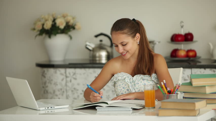 Beautiful Girl Sitting At Table Stock Footage Video 100 Royalty Free 4955129 Shutterstock