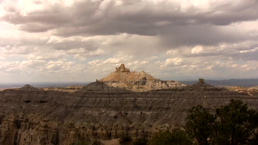 HD zoom in from a wide view of the badlands of northern New Mexico to a tight view of Angels Peak