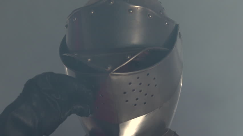 Knight walking in fog and lifts mask | Shutterstock HD Video #4979933