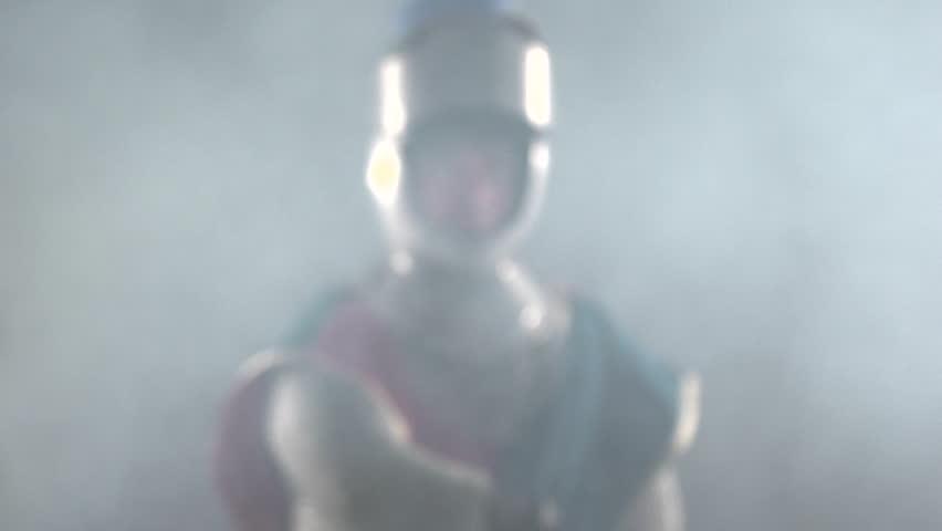 Medium shot of knight drawing his sword | Shutterstock HD Video #4979942