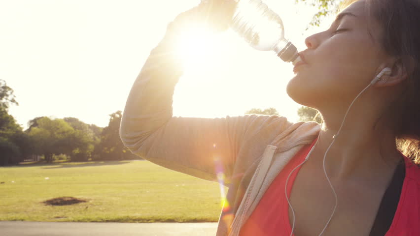 Fitness woman drinking water outdoors in park | Shutterstock HD Video #4982204