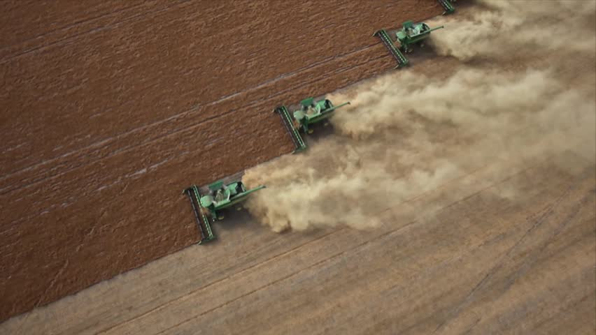 Four combines harvesting lentil field on the Saskatchewan Prairie aerial view | Shutterstock HD Video #4988255