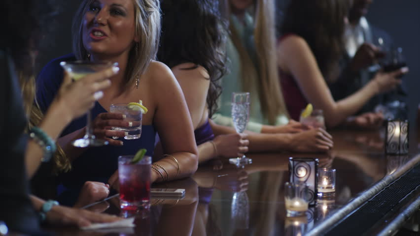 Close up of people hands at a bar drinking drinks | Shutterstock HD Video #4991519