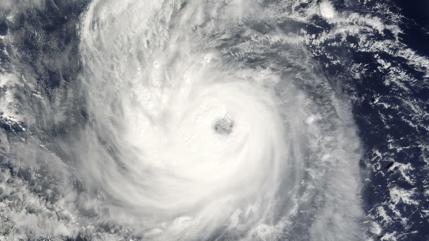 Descent into the well defined eye of a large typhoon / hurricane as it churns in the ocean. (Elements furnished by NASA)