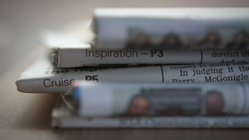Stack Of Newspapers. A close up dolly of a stack of Newspapers filmed on the Blackmagic Cinema Camera. | Shutterstock HD Video #5000522