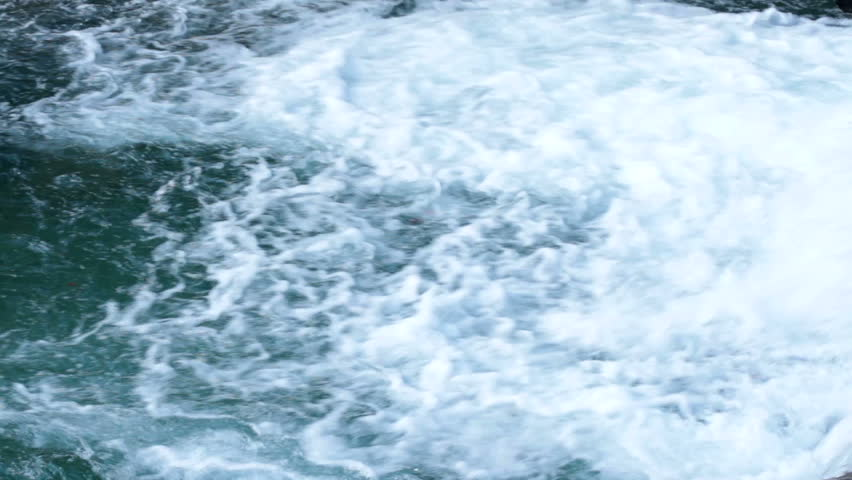Close up on water at the bottom of a small waterfall. High definition video.   Shutterstock HD Video #5004599
