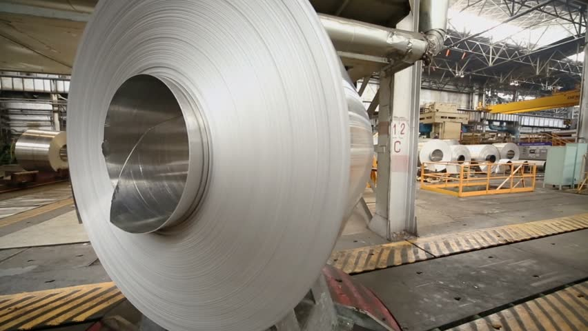 Transporter turns and moves big roll of aluminum in workshop  | Shutterstock HD Video #5011217
