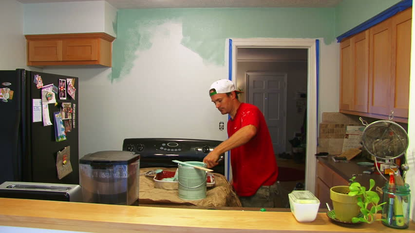 Man and woman couple paint kitchen, time lapse sequence. #5018528