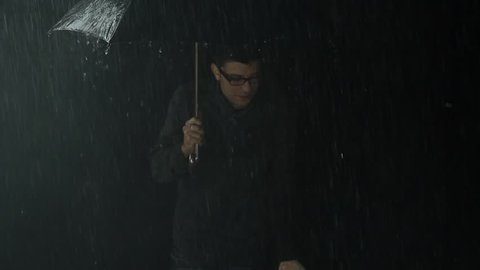Young Man Cold Freezing in Rain Bad Weather Storm Concept