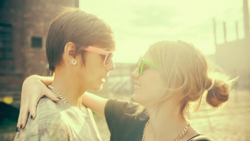 Teenage hipster boyfriend and girlfriend having fun in the sun with vintage color correction