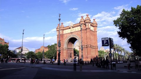 BARCELONA, SPAIN - AUGUST 21, 2013: Timelapse Arc de Triomf and road to famous park. Landmark with tourists and locals in Barcelona, Spain on August 21, 2013. Traffic on road (TIME LAPSE)