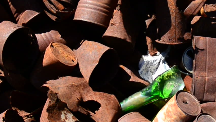 Pan of Rusting Tin Cans in a Mojave Desert | Shutterstock HD Video #5042033