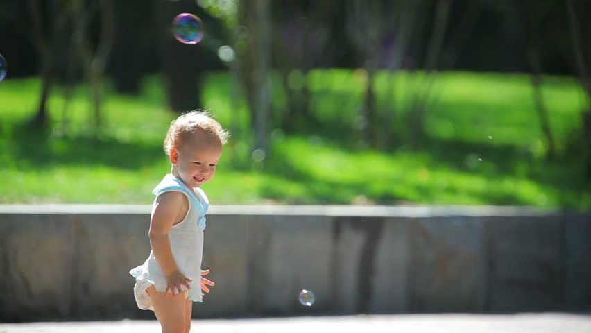 The girl and soap bubbles