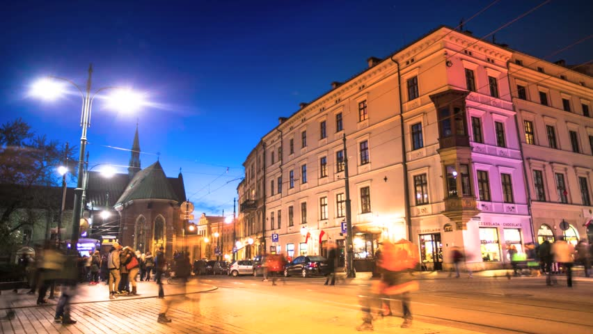 Timelapse: Crossroads on the busy street in the center of Krakow at night time,