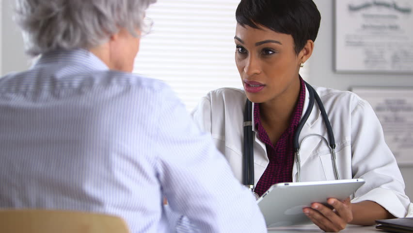 Doctor giving consultation to patient