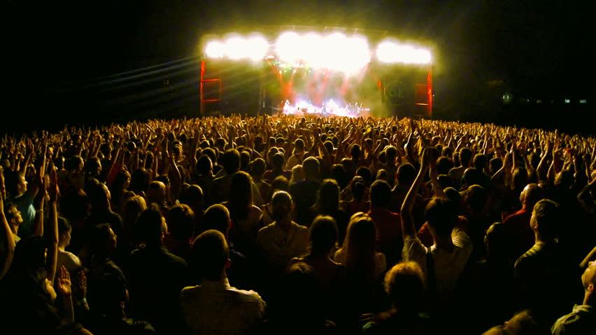 Crowd at a rock concert, back light silhouette    Shutterstock HD Video #5073602
