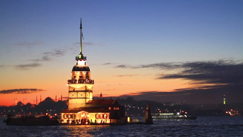 Istanbul Maidens Tower (KIZ Kulesi) from the east in sunset. In the distance are such landmarks as Blue Mosque, Hagia Sophia and Topkapi Palace.