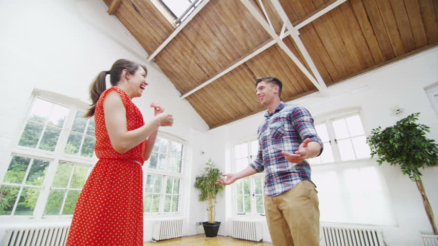 Happy young couple viewing a potential new home.  | Shutterstock HD Video #5099228