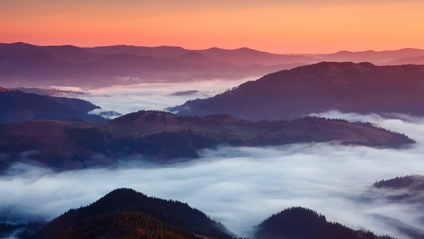 Time lapse clip. Fantastic mountain landscape with colorful cloud. Carpathian,