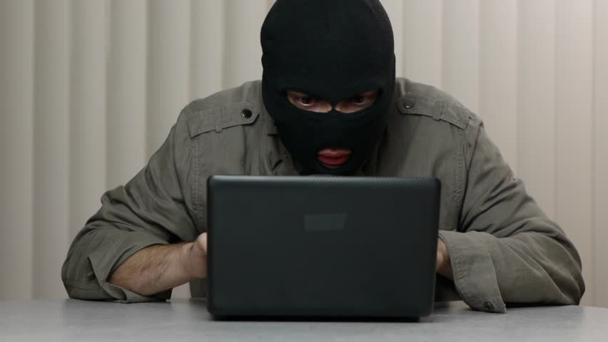 Hacker theft working with a laptop computer. Great video for and project involving cyber criminality and thief