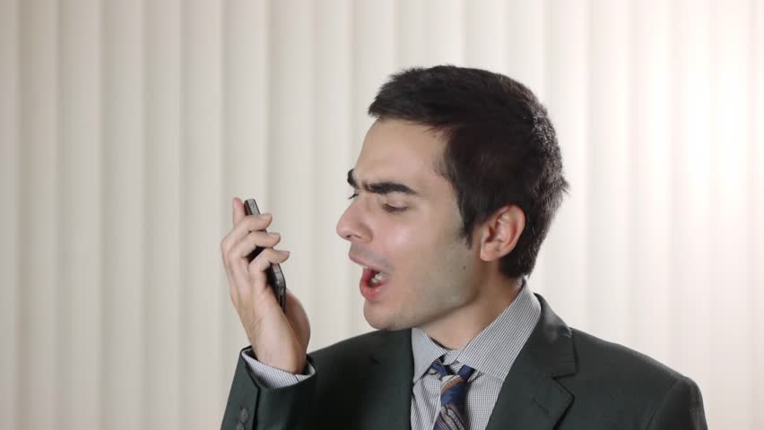 Frustrated man yelling at his smartphone