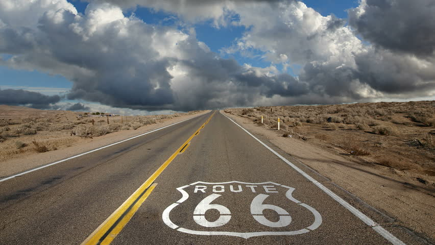 Route 66 highway pavement sign with time lapse clouds. | Shutterstock HD Video #5118581
