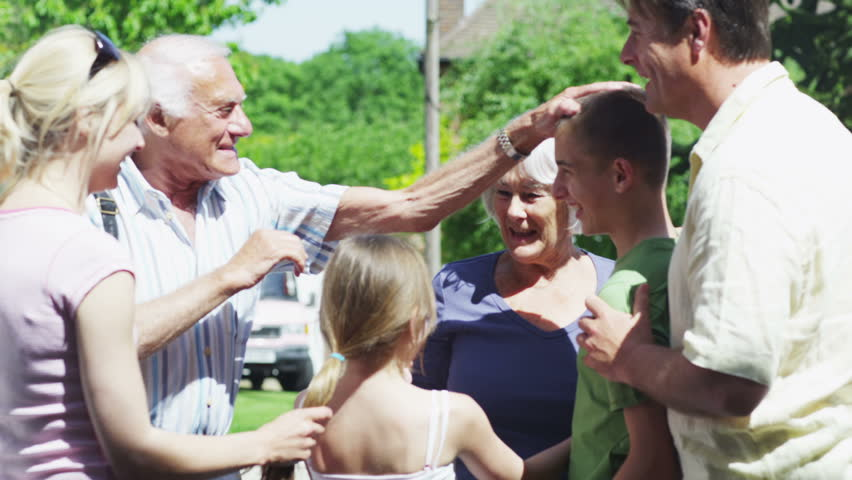 Grandparents arrive at the home of their children and grandchildren for a family visit. In slow motion.