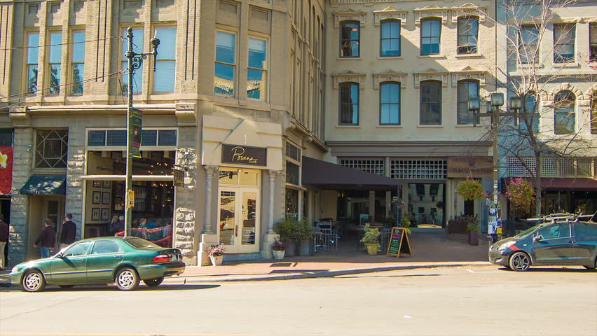 People and Cars at Cafe's and Restaurants in Downtown Asheville, NC on a Sunny Autumn Morning.