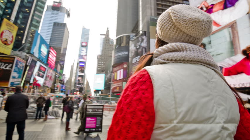 NEW YORK - NOVEMBER 12, 2013: 360 degree panorama of beautiful female tourist in Times Square in New York City. Times Square is a major intersection in Manhattan NYC USA.