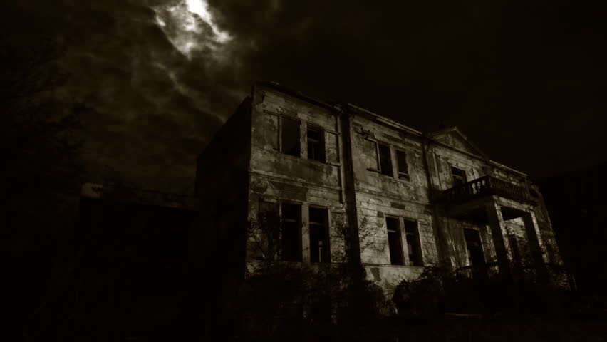 Old creepy ruins of the old hotel at night