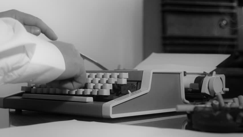 Smoking journalist typing on a portable typewriter in grey scale | Shutterstock HD Video #5157890