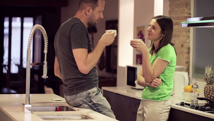 Young Couple Talking and Drinking Stock Footage Video (100% Royalty-free)  5172605   Shutterstock