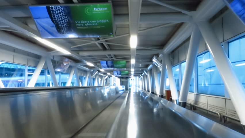 Escalator and modern architecture airport in Rome pov | Shutterstock HD Video #5174090