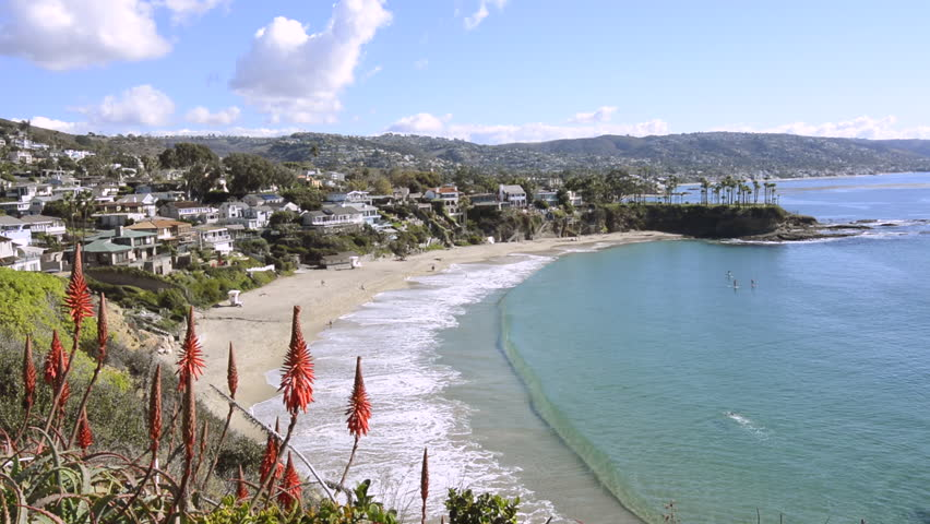 A beautiful cliff side view of Crescent Bay Beach in Laguna Beach, California shows the scenic, turquoise water and the white sand beach. #5178470