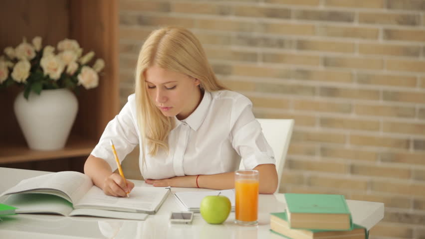 Charming Girl Sitting at Desk Stock Footage Video (100% Royalty-free)  5178839 | Shutterstock