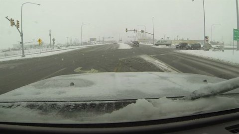 Winter storm truck enter freeway POV HD. First winter snow storm hit West and Midwest USA with extreme cold weather and snow. Dangerous driving conditions on snow packed and icy roads and highways.