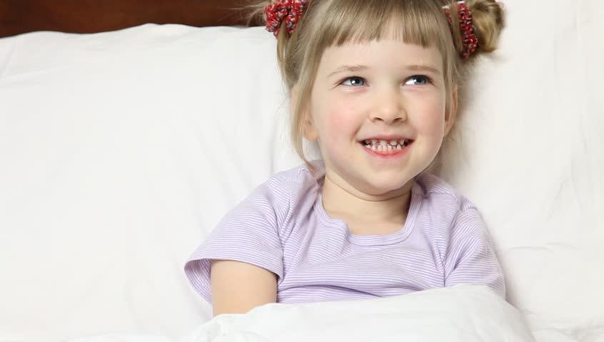 Little girl taking medicine in bed   Shutterstock HD Video #5185928