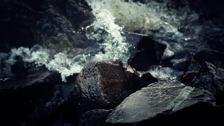 Water splashing against rocks (super slow motion) #5207477