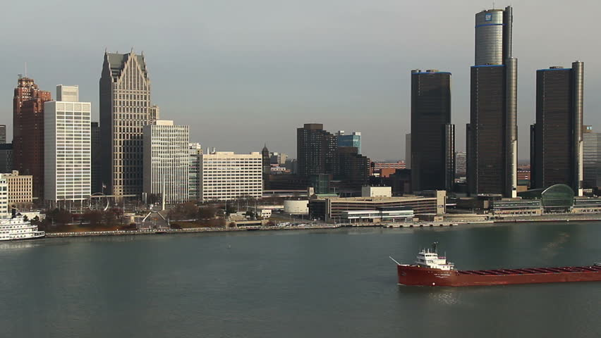 DETROIT - CIRCA NOVEMBER 2013: City skyline during a cold winter morning with a cargo ship passing, circa November 2013 in Detroit, Michigan.