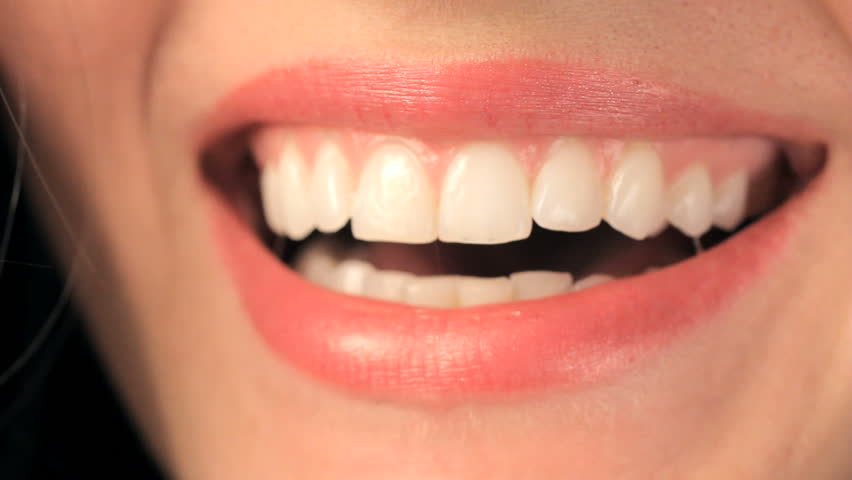 Teeth showing smiling meaning without What does