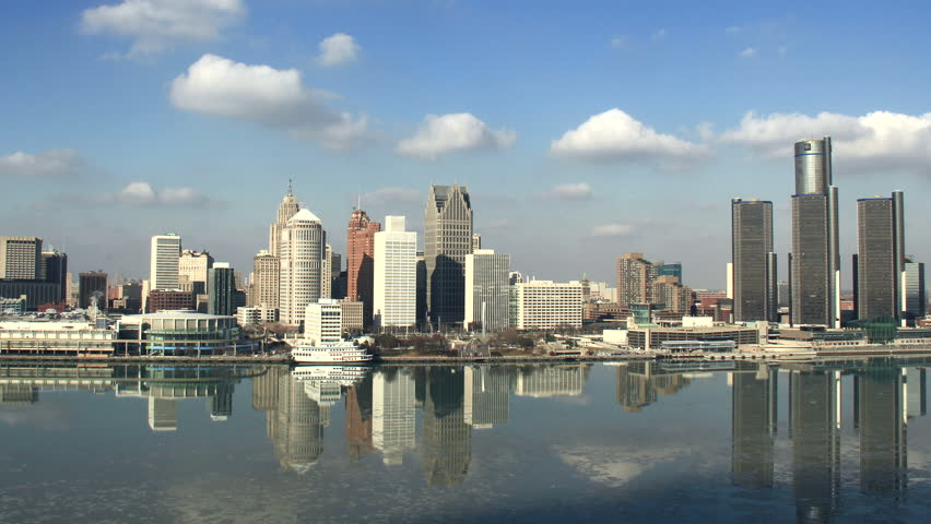 DETROIT - CIRCA NOVEMBER 2013: City skyline during a cold winter afternoon shot in time lapse, with a slight zoom out, circa November 2013 in Detroit, Michigan.