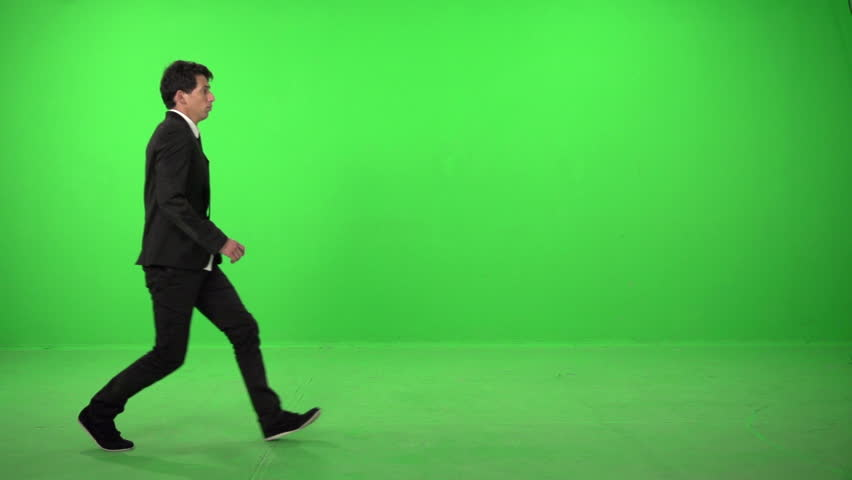 Dancer dressed as business man on a green screen in slow motion 200fps #5226320