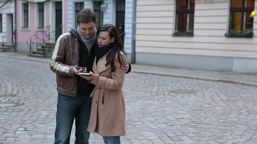 Couple using map and smartphone in city to find directions (Full HD)   Shutterstock HD Video #5231873