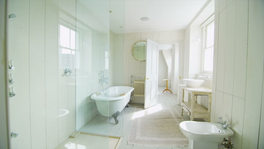 View of elegant bathroom in a stylish, classically designed home with a contemporary feel. No people. | Shutterstock HD Video #5239586
