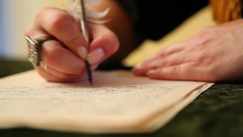 Woman writes a letter | Shutterstock HD Video #5247671
