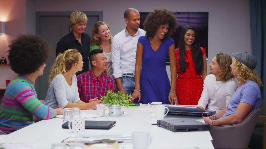 Portrait of a cheerful casual business team gathered together for a boardroom meeting. | Shutterstock HD Video #5259476