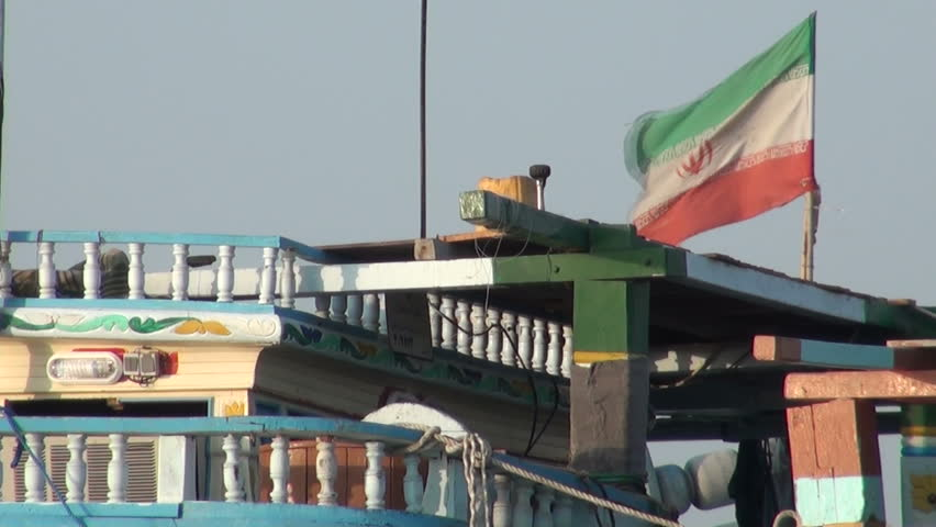 The Iranian flag on a classic wooden fishing boat in Bandar Abbas, a city on the Persian Gulf, in Iran