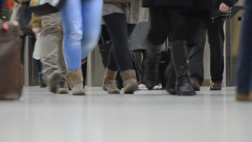 Low angle view of business commuters and travelers moving at a busy public space. High quality HD video footage | Shutterstock HD Video #5266172