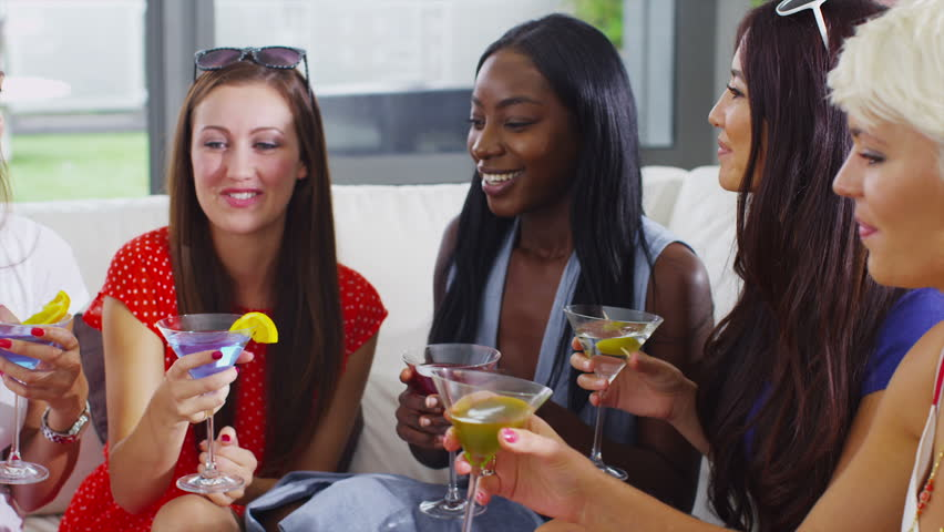 Happy attractive group of friends socializing with drinks in modern home. In slow motion. | Shutterstock HD Video #5268476